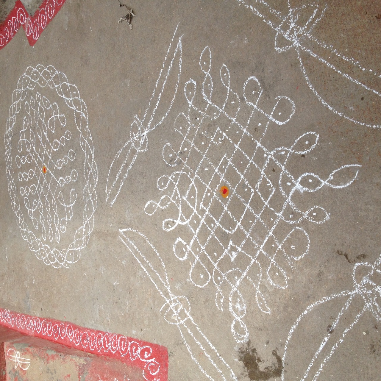 Drawing chalk on the ground outside your home to invite Lakshmi in (the goddess of wealth)