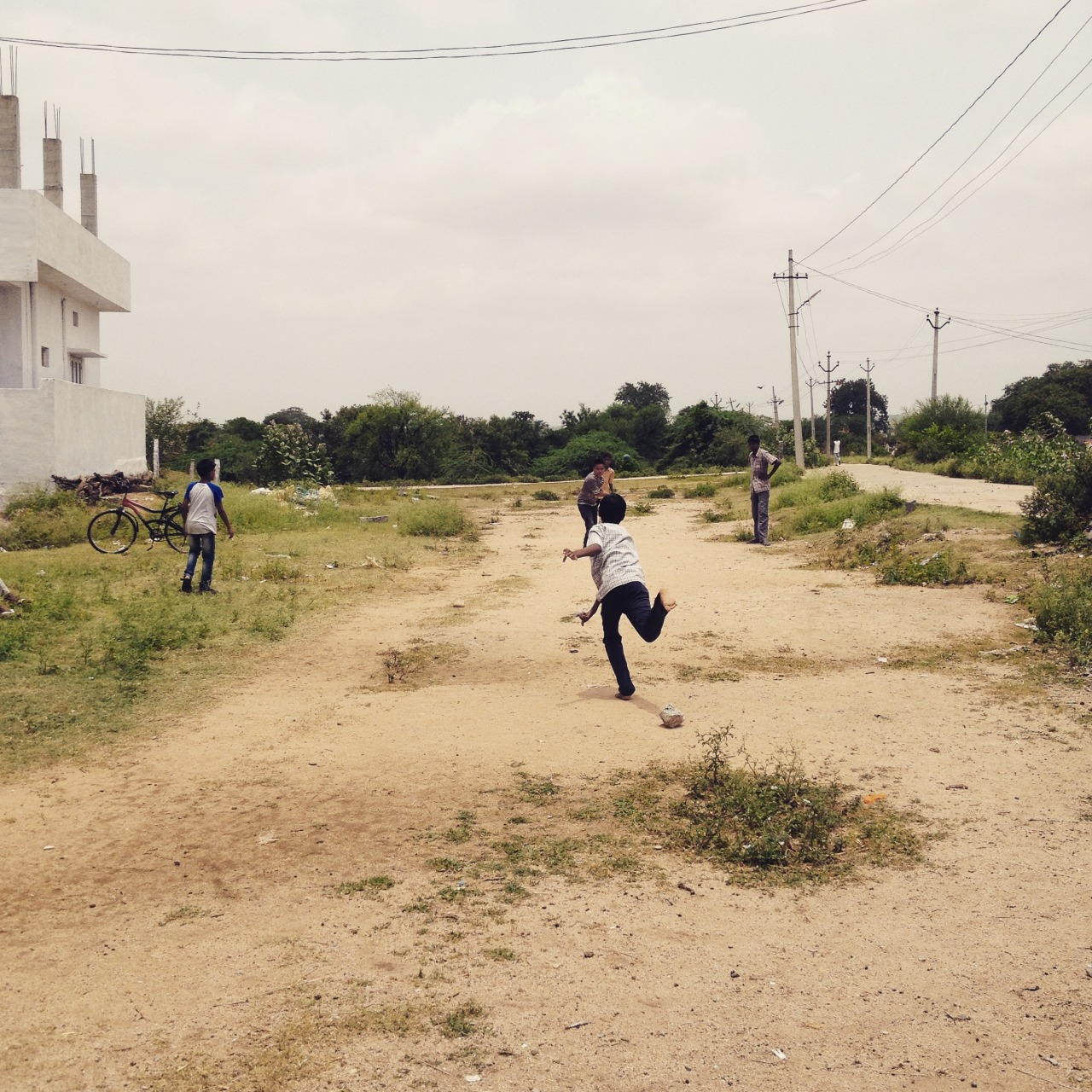Playing cricket in the village