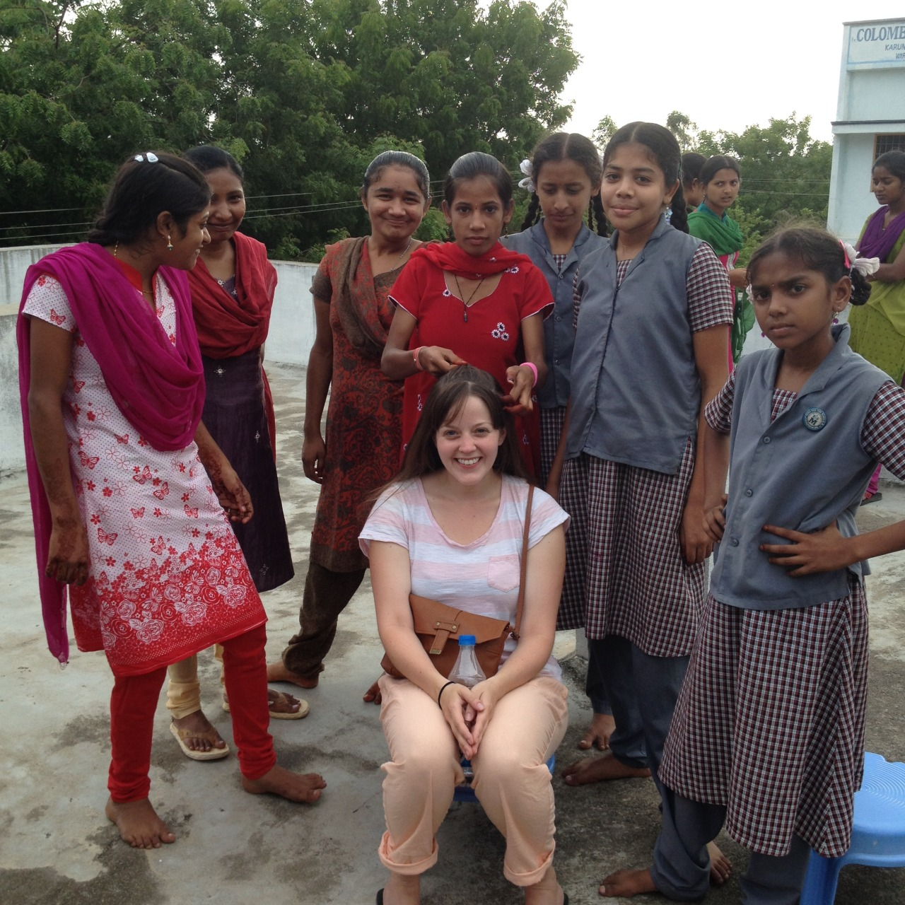 Bonding with the orphans at the HIV centre, who insisted on doing my hair