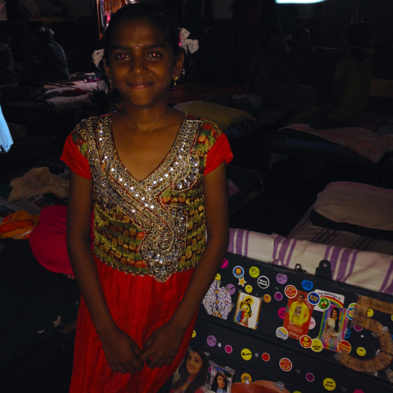 My friend Swapna, an HIV positive orphan. This tiny cupboard holds everything she owns