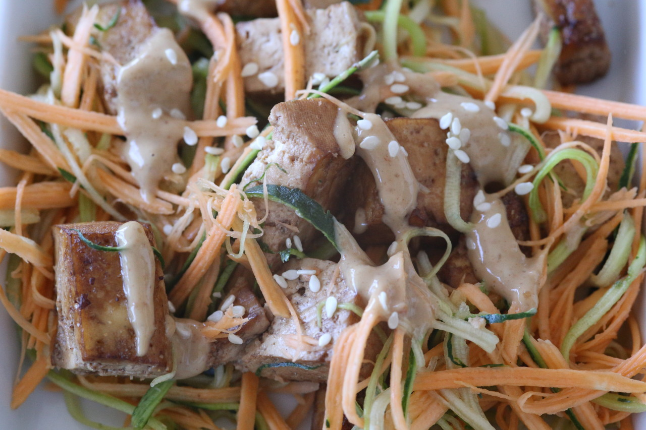 Raw sweet potato salad with peanut dressing