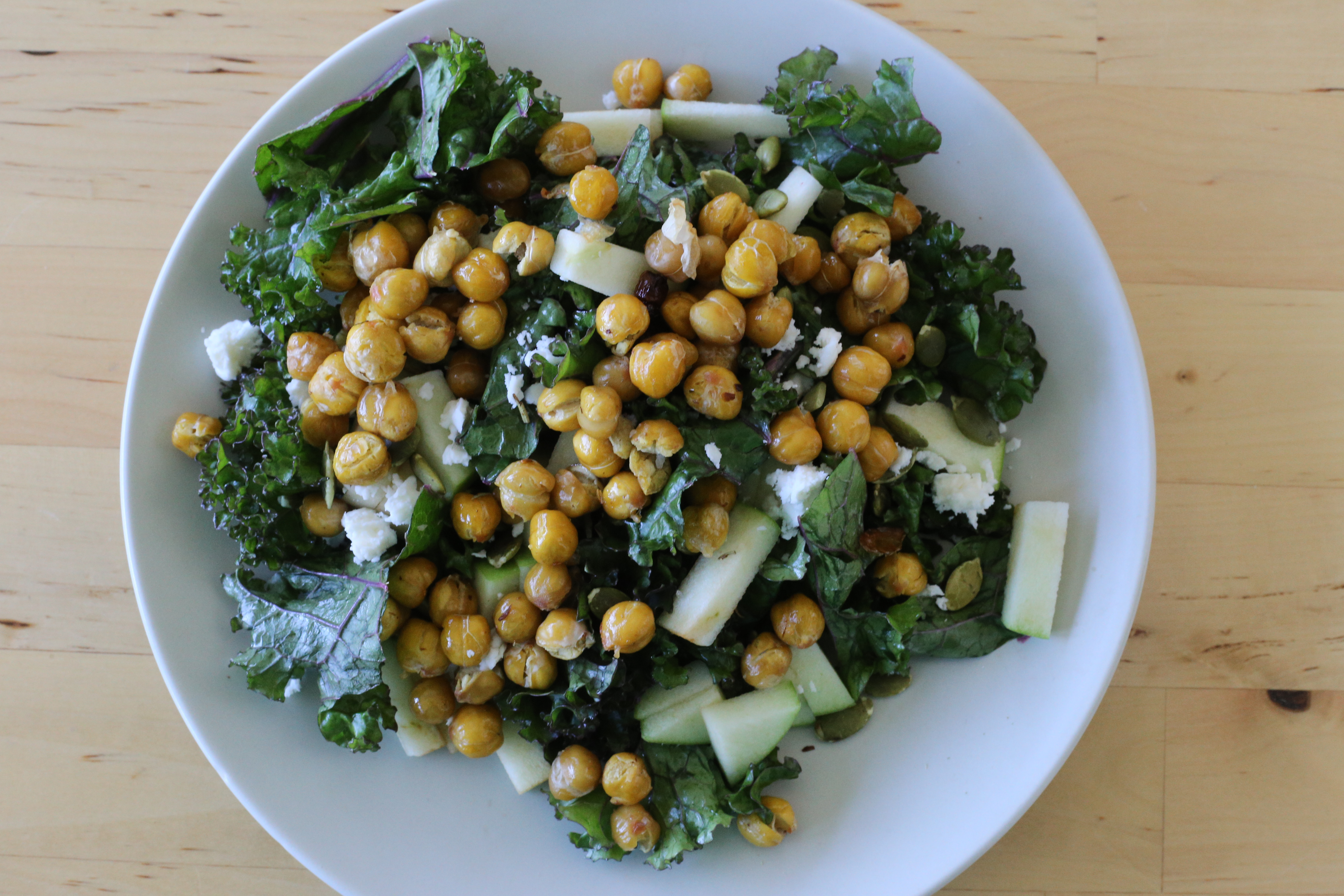 Then top with crunchy roasted chickpeas, pumpkin seeds, and feta.