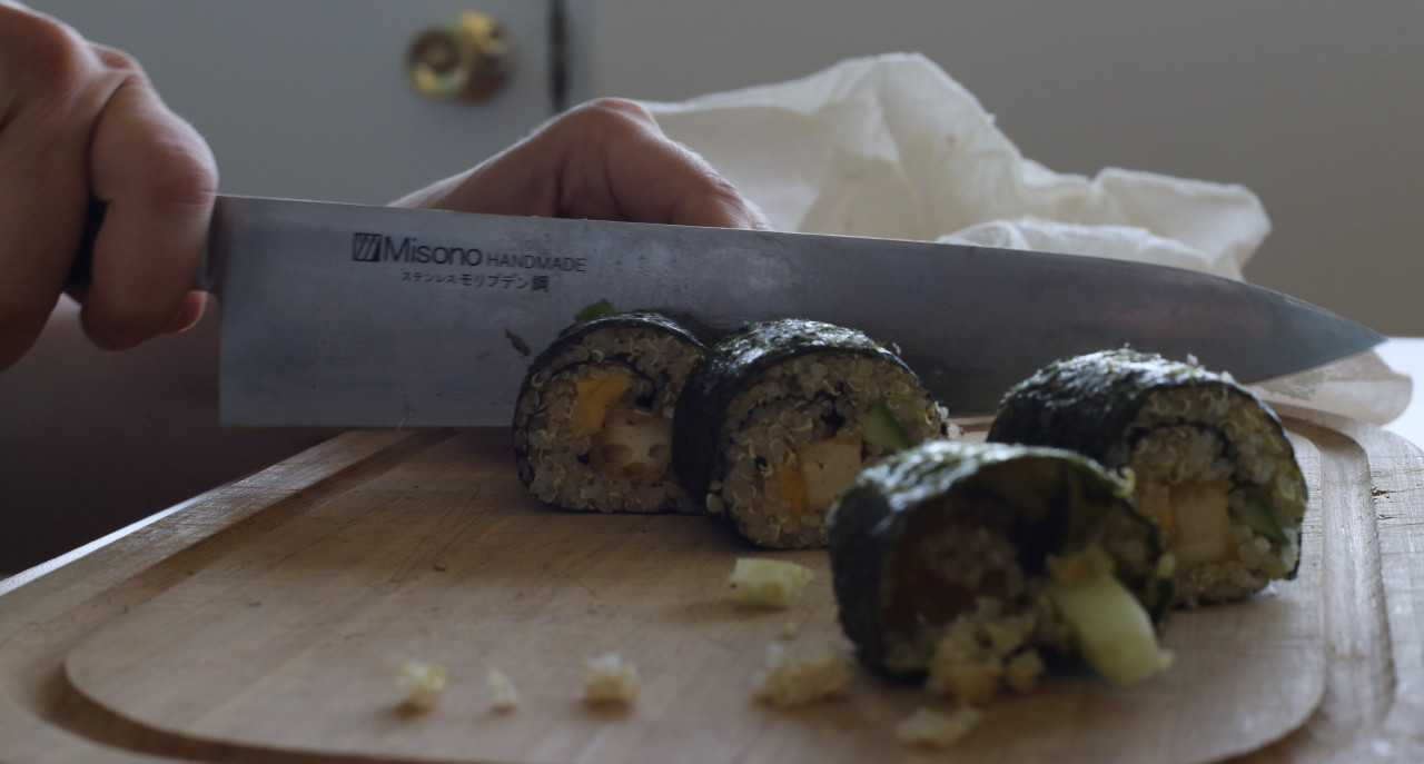 Making quinoa mango maki